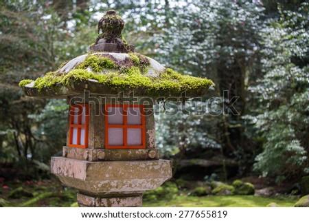 Japanese Stone Lantern in the Shrine - stock photo