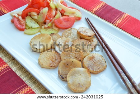 Japanese style fried radish with salad on a plate
