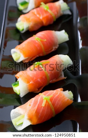 Japanese style hors d'oeuvre, made by smoked salmon - stock photo