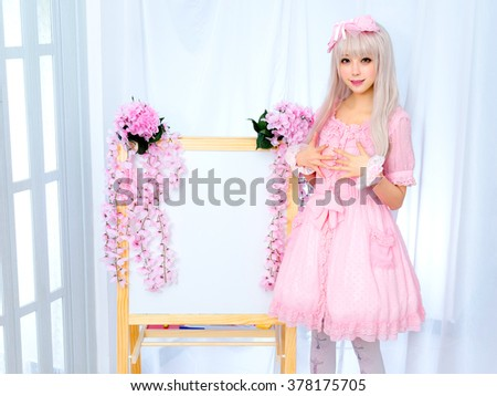 japanese style lolita maid cosplay cute girl with board - stock photo
