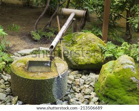 Japanese style traditional bamboo fountain at Ryoan-ji temple, Kyoto, Japan. - stock photo