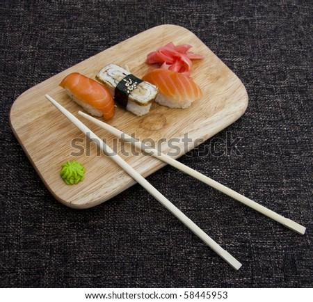 Japanese sushi and rolls - stock photo