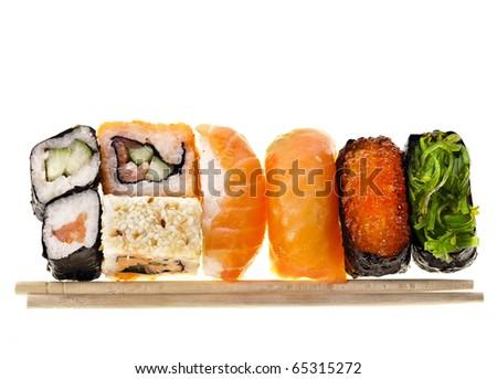 Japanese sushi food and chopsticks isolated - stock photo