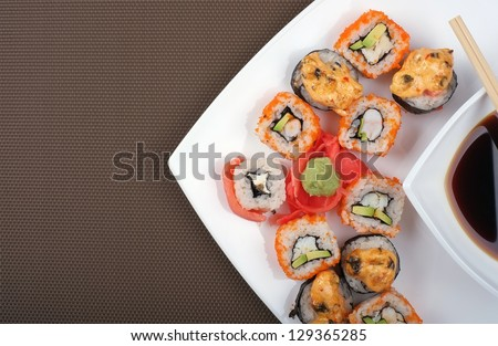 Japanese sushi on a plate with space for text. Top view - stock photo