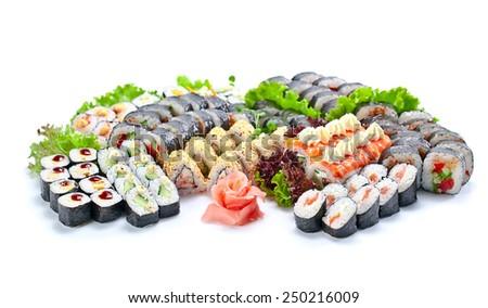 Japanese sushi on a white reflexive background - stock photo