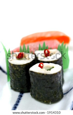 Japanese sushi on white plate with chopstick in the background isolated on white