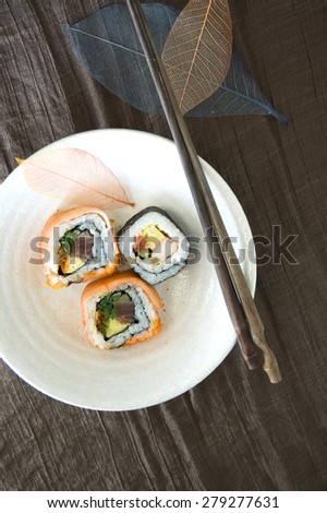 japanese sushi roll dish with wooden chopstick - stock photo