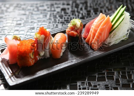 Japanese sushi roll on a black plate