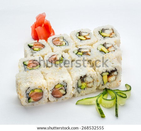 Japanese sushi & roll set on a white background with ginger and cucumber - stock photo