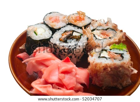 Japanese sushi rolls in plate on white background. Isolation, shallow DOF