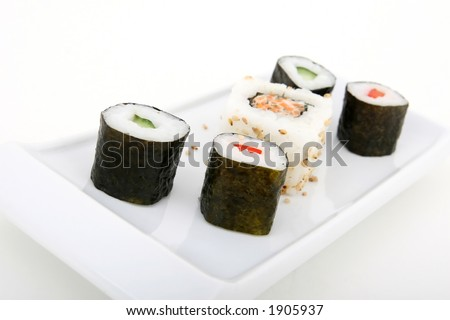 Japanese sushi seafood rolls with rice and sesame - stock photo