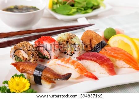 Japanese sushi selection with chopsticks - stock photo