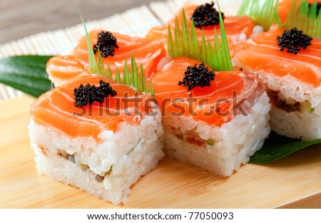 Japanese sushi  traditional japanese food.Roll made of salmon - stock photo