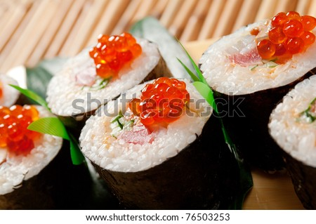 Japanese sushi  traditional japanese food.Roll made of Smoked fish and red roe - stock photo