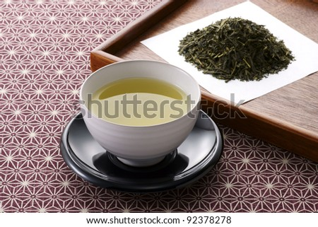 japanese  tea leaves and hot green tea - stock photo