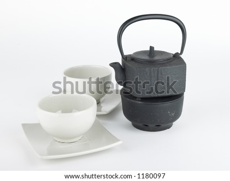Japanese tea pot and cups - stock photo