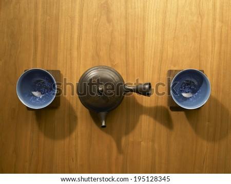 Japanese teapot on wooden background - stock photo