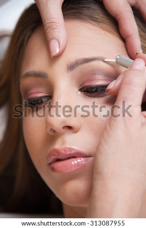Japanese technique of drawing eyebrows - stock photo