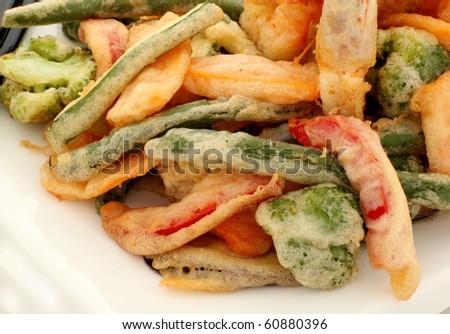 Japanese tempura with fresh vegetables fried in a light batter. - stock photo