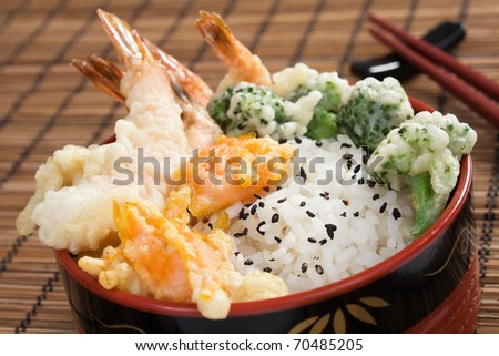 Japanese tendon - lightly battered tempura shrimp, broccoli, and carrots served over rice. - stock photo