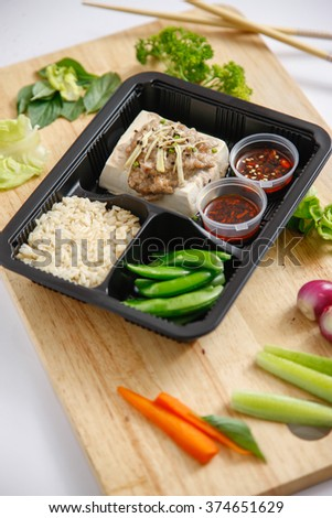 Japanese tofu, Japanese soft cold tofu with sauce and rice in a dish on dining table. - stock photo