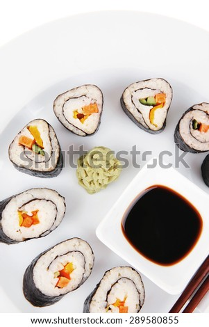 Japanese traditional Cuisine - Roll with Cucumber , Cream Cheese with raw Tuna(maguro) and Salmon(sake) inside. on white dish with sticks isolated over white background - stock photo