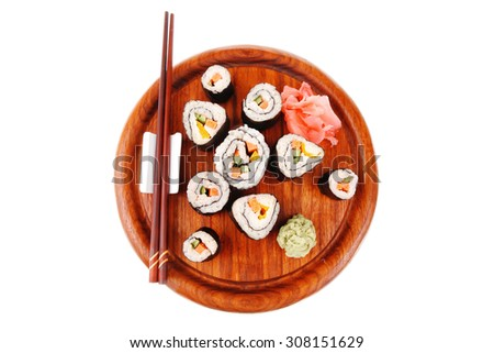 Japanese traditional Cuisine - Roll with Cucumber , Cream Cheese with raw Tuna(maguro) and Salmon(sake) inside. on wooden plate with wasabi and ginger isolated over white background - stock photo