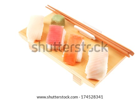 Japanese traditional cuisine - Set of Tuna (maguro) Salmon (sake) and Eel (unagi) Nigiri Sushi  with Wasabi  and chopstick on wooden plate isolated over white background - stock photo