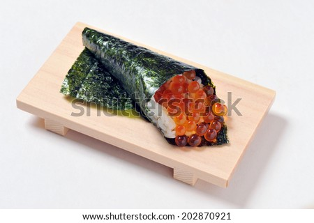 Japanese traditional cuisine- Sushi temaki on wooden plate isolated over white background-5 - stock photo