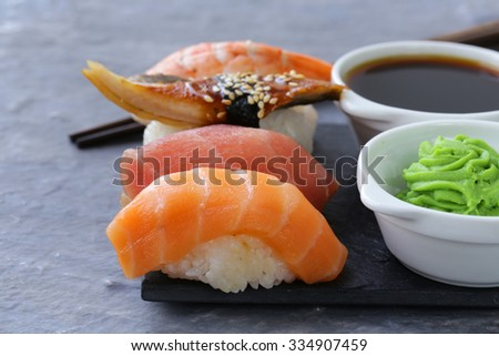 Japanese traditional food sushi with salmon, tuna and shrimp - stock photo