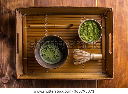 Japanese traditional tea set with powdered green tea  - stock photo