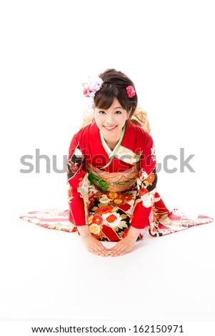 japanese traditional woman sitting on white background - stock photo