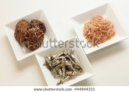 japanese umami taste, ingredients of dashi(japanese soup stock), katsuobushi,kombu,niboshi and hoshi shiitake - stock photo