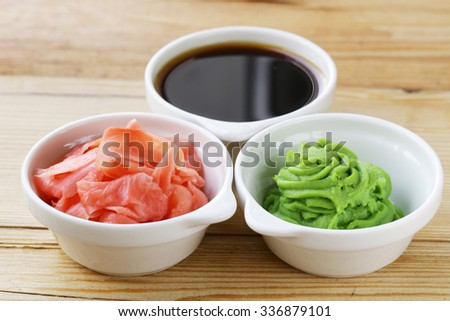 Japanese wasabi sauce, soy sauce and pickled ginger - stock photo