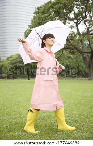 Japanese woman checking for whether the rain is falling