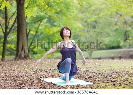 Japanese woman doing yoga - stock photo