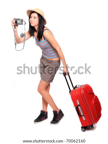 Japanese woman going on vacation with camera and her suitcase. - stock photo