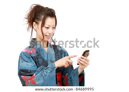Japanese woman in clothes of kimono with mobile phone - stock photo