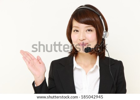 Japanese woman  of call center presenting and showing something  - stock photo