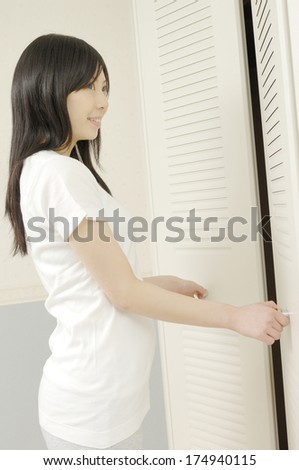 Japanese Woman opening the closet