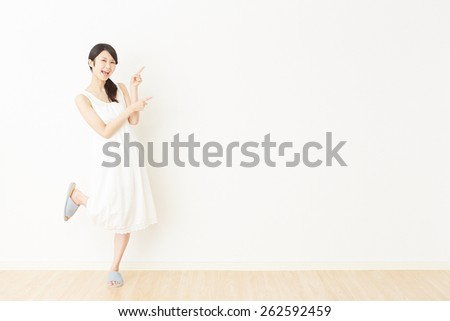 Japanese woman pointing side - stock photo