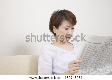Japanese woman reading a newspaper,