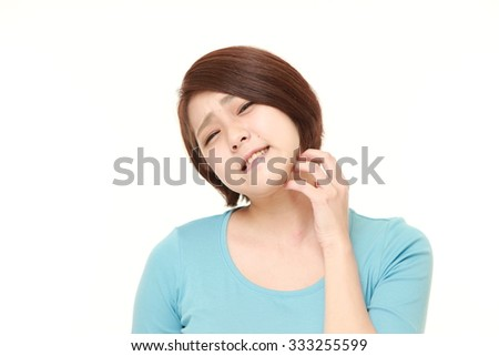 Japanese woman scratching her neck - stock photo