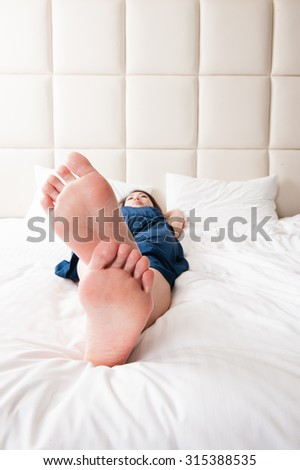 Japanese woman sleeping in bed