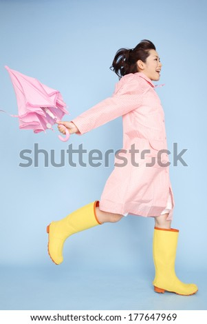 Japanese woman to jump wearing rain gear