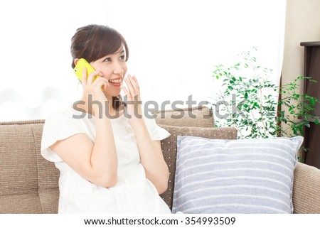 Japanese woman uses a mobile phone - stock photo