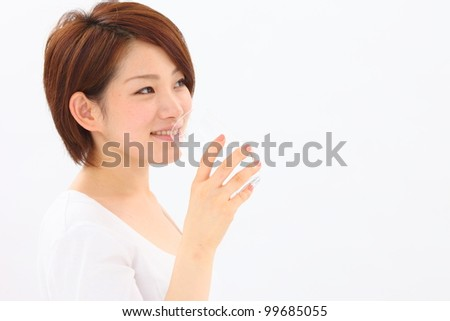 Japanese woman wearing a bathrobe - stock photo