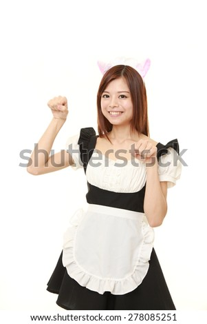 Japanese woman wearing french maid costume with cat ears in cat pose