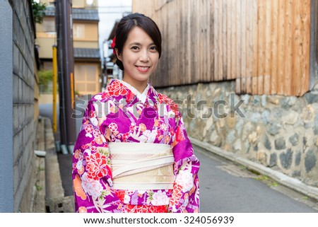 Japanese woman with kimono dressing in Kyoto - stock photo