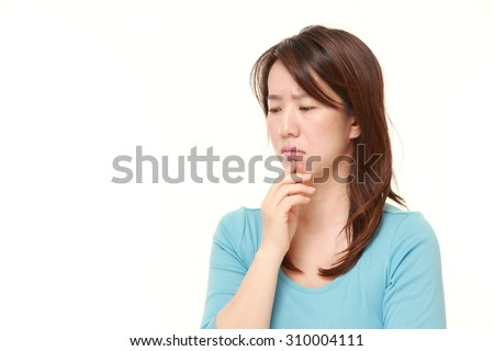 Japanese woman worries about something - stock photo